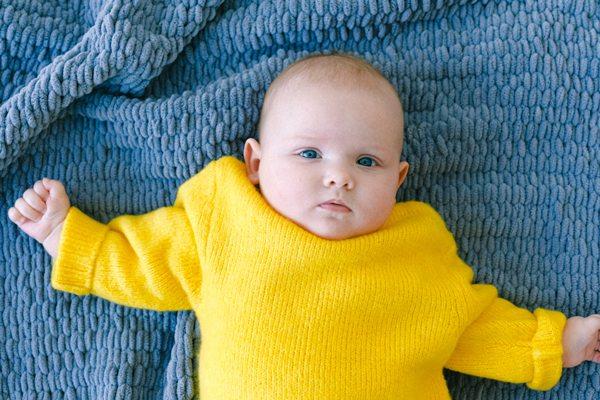 Canva Baby in White Onesie